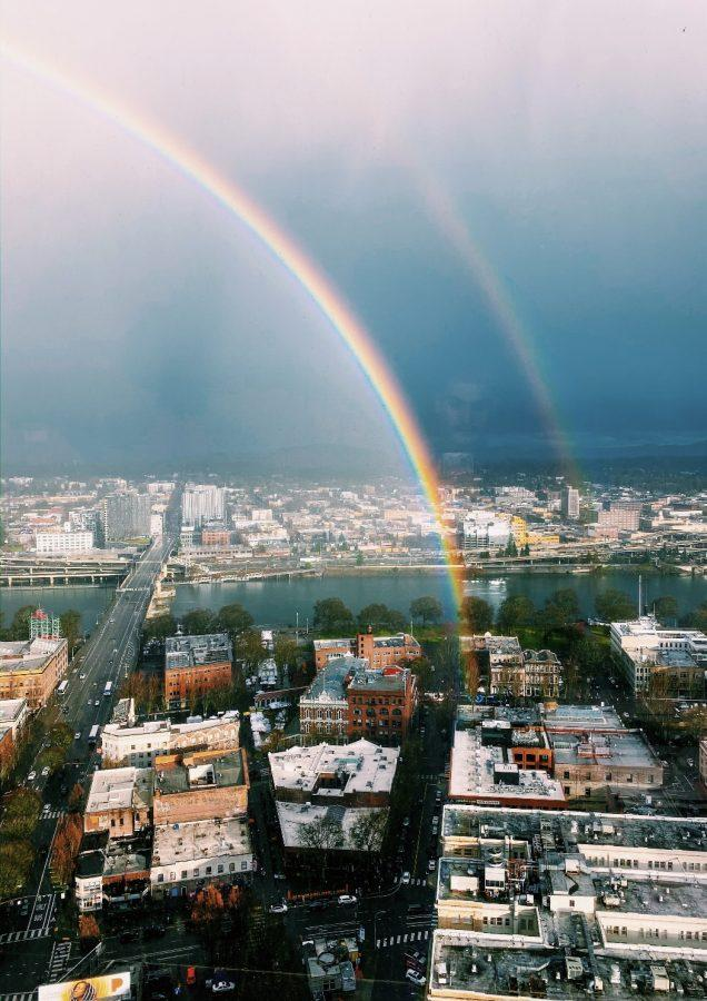 A double rainbow appearing on a Portland afternoon. After the pouring rain came two rainbows flowing into the city.