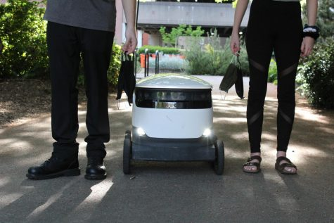 In these times, students find themselves thinking about what college would have been like if COVID was not around. Pictured is our reality, robots delivering your food, masks, and people standing six feet apart.