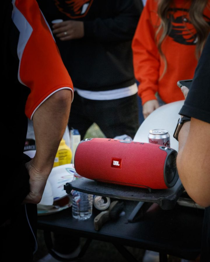 JBL speaker in the middle of tailgating party