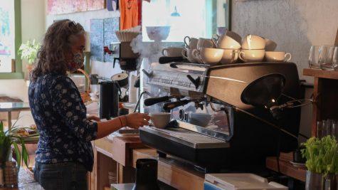 Hattie preparing coffee from espresso machine